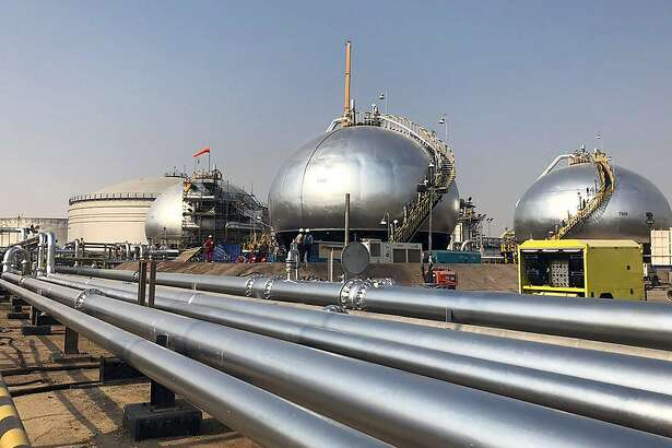 Three-phase spheroids stand behind pipelines at Saudi Aramco's crude oil processing facility, in Abqaiq, Saudi Arabia, on Saturday, Oct. 12, 2019. Aramco showed it has made significant progress in restoring damaged oil infrastructure to normal operation just a month after a devastating aerial attack halted production. Photographer: Dina Khrennikova/Bloomber