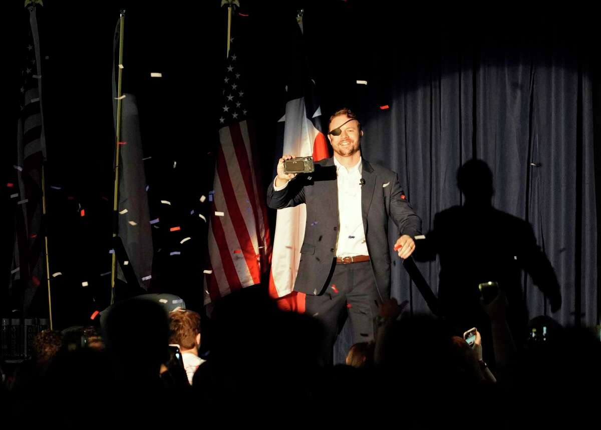 Congressman Dan Crenshaw takes with stage during the Youth Summit hosted by Crenshaw at the Hyatt Regency Houston, 1200 Louisiana St., Sunday, Sept. 15, 2019, in Houston. The event was for high school and college students.