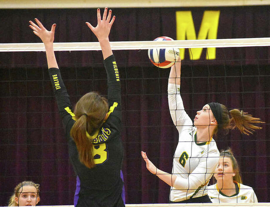 MELHS outside hitter Anne Kienle goes up for an attack during the first game against Mount Olive on Monday. Photo: Matt Kamp|The Intelligencer