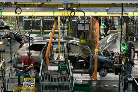 FILE -- A Buick makes its way down the assembly line at the General Motors assembly line in Lansing, Mich., on March 5, 2017. Breaking with some of their biggest rivals, General Motors, Fiat Chrysler and Toyota said Oct. 28, 2019, they were intervening on the side of the Trump administration in an escalating battle with California over fuel economy standards for automobiles. (Brittany Greeson/The New York Times)