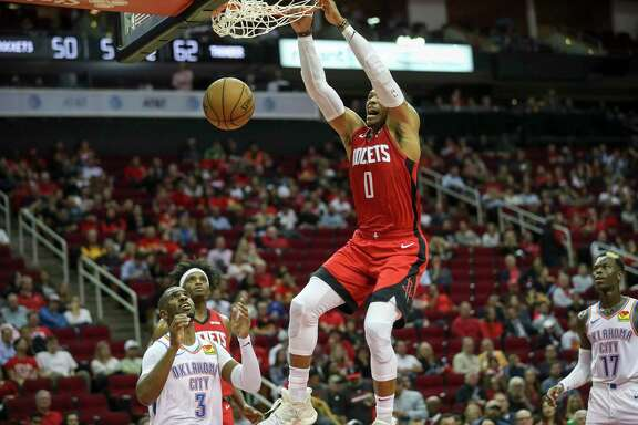 Houston Rockets guard Russell Westbrook (0) gets a basket as Oklahoma City Thunder guard Chris Paul (3) looks on during the second quarter of an NBA basketball game at the Toyota Center on Monday, Oct. 28, 2019, in Houston.