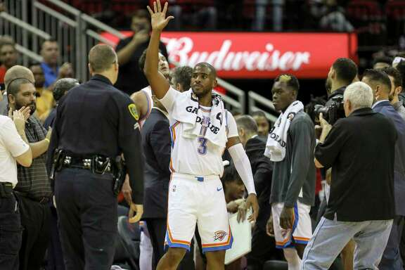 Oklahoma City Thunder guard Chris Paul (3) and former Houston Rocket is introduced to the crowd during the first quarter of an NBA basketball game at the Toyota Center on Monday, Oct. 28, 2019, in Houston.