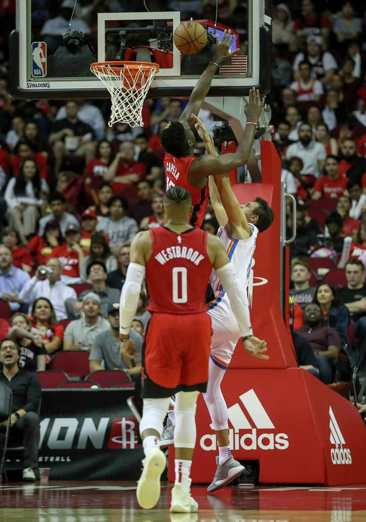 Houston Rockets center Clint Capela (15) stops a shot by Oklahoma City Thunder forward Danilo Gallinari (8) during the second quarter of an NBA basketball game at the Toyota Center on Monday, Oct. 28, 2019, in Houston.