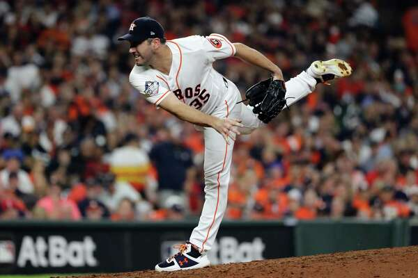 HOUSTON, TEXAS - OCTOBER 23: Justin Verlander #35 of the Houston Astros delivers the pitch against the Washington Nationals during the fifth inning in Game Two of the 2019 World Series at Minute Maid Park on October 23, 2019 in Houston, Texas. (Photo by Elsa/Getty Images)