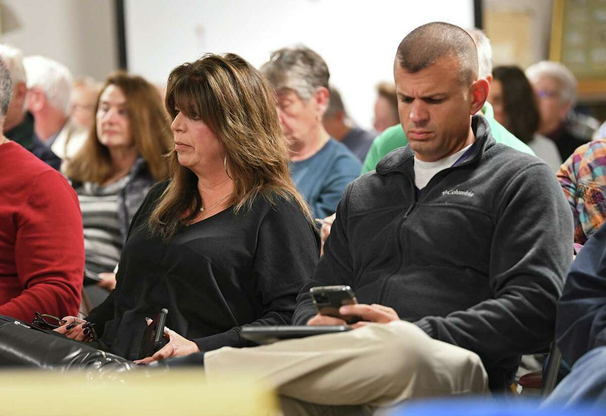 Gina Marozzi and her brother Frank Rossi, Jr. are seen at a public village meeting at Ballston Spa Library on Monday, Oct. 28, 2019 in Ballston Spa, N.Y. Ballston Spa village trustee Liz Kormos says it appears the Rossi has not paid required water and sewer fees on an apartment complex.  (Lori Van Buren/Times Union)