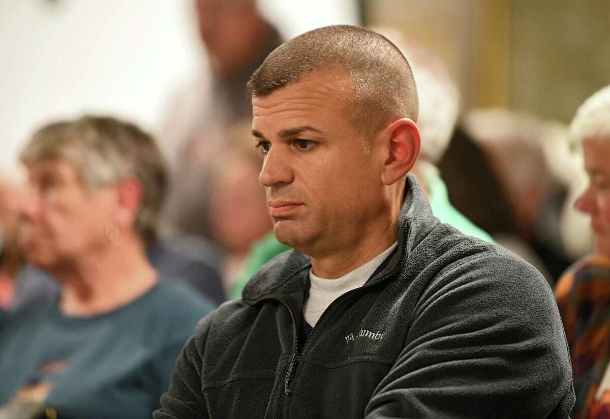 Frank Rossi, Jr. is seen at a public village meeting at Ballston Spa Library on Monday, Oct. 28, 2019 in Ballston Spa, N.Y. The Rossi family insisted tresspassing charges be brought against two Democratic political canvassers at one of their senior apartment complexes. After two years, prosecutors dropped the case in Aug. 2021. (Lori Van Buren/Times Union)