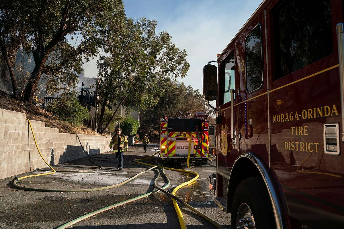 Moraga firefighters work to extinguish a fire at the Lafayette Tennis Club, in Calif. on Sunday, Oct. 27, 2019.