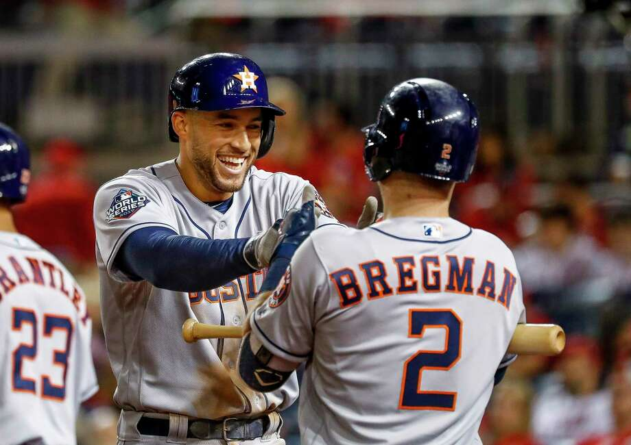 Houston Astros right fielder George Springer (4) celebrates with Houston Astros third baseman Alex Bregman (2) after Springer hit a two-run home run during the ninth inning of Game 5 of the World Series at Nationals Park in Washington, D.C. on Sunday, Oct. 27, 2019. Photo: Karen Warren, Houston Chronicle / Staff Photographer / © 2019 Houston Chronicle