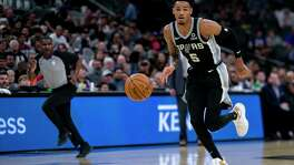 San Antonio Spurs' Dejounte Murray drives the ball down the court as the Spurs host the Portland Trail Blazers at AT&T Center San Antonio, Texas, on Oct. 28, 2019.