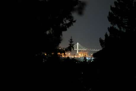 The Bay Bridge is seen in the distance from Wyngaard Avenue and Estates Drive, a neighborhood that has no power in Oakland, Calif. on Monday, Oct. 28, 2019.