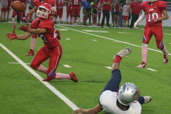 Thompson Intermediate's Daniel Campero prepares to haul in this deflected Bondy pass during second-quarter action at Veterans Memorial Stadium Monday night. It was one of four interceptions on the night.