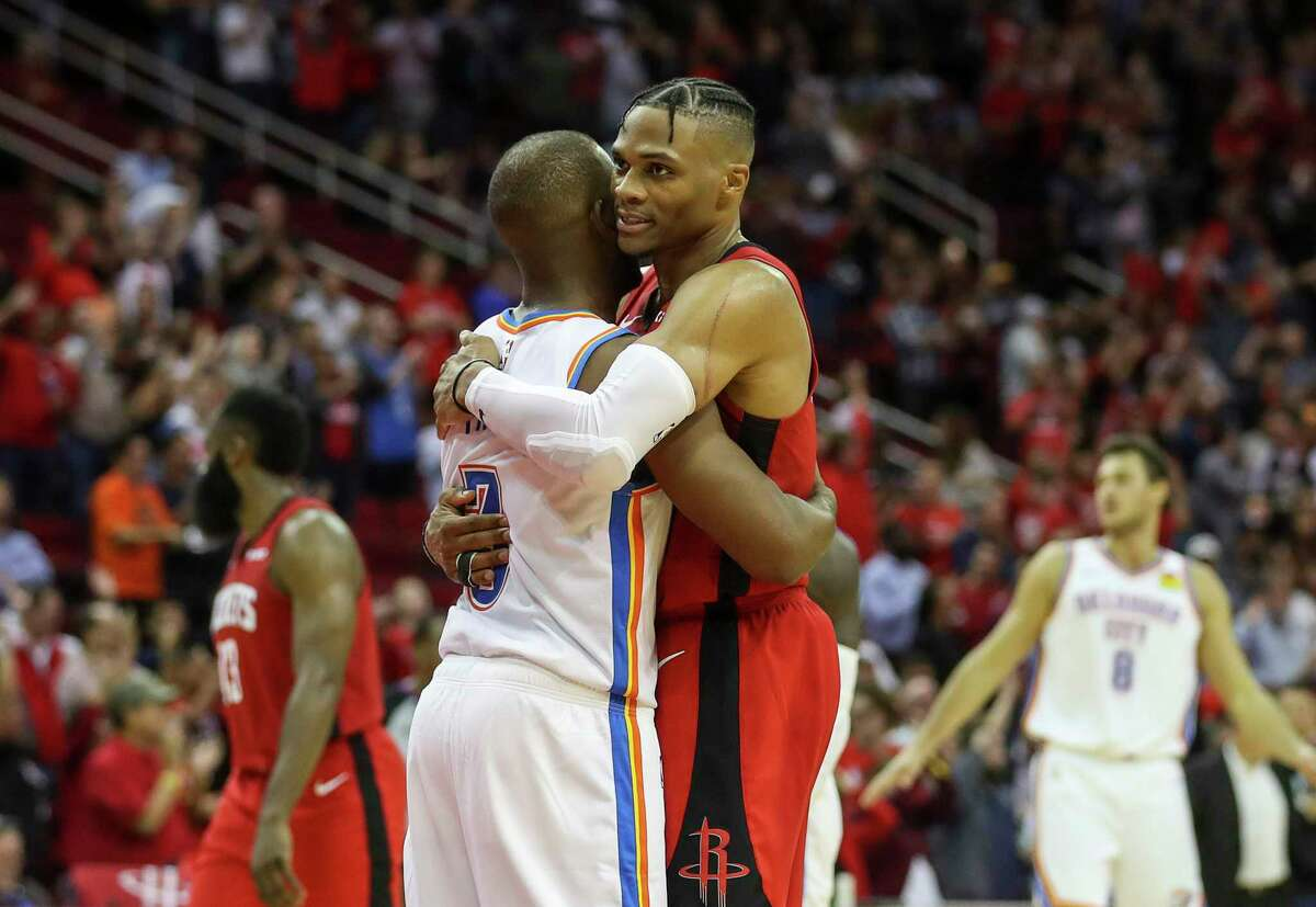 Houston Rockets guard Russell Westbrook (0) hugs Oklahoma City Thunder guard Chris Paul (3) after the Houston Rockets beat the Oklahoma City Thunder at the Toyota Center on Monday, Oct. 28, 2019, in Houston.