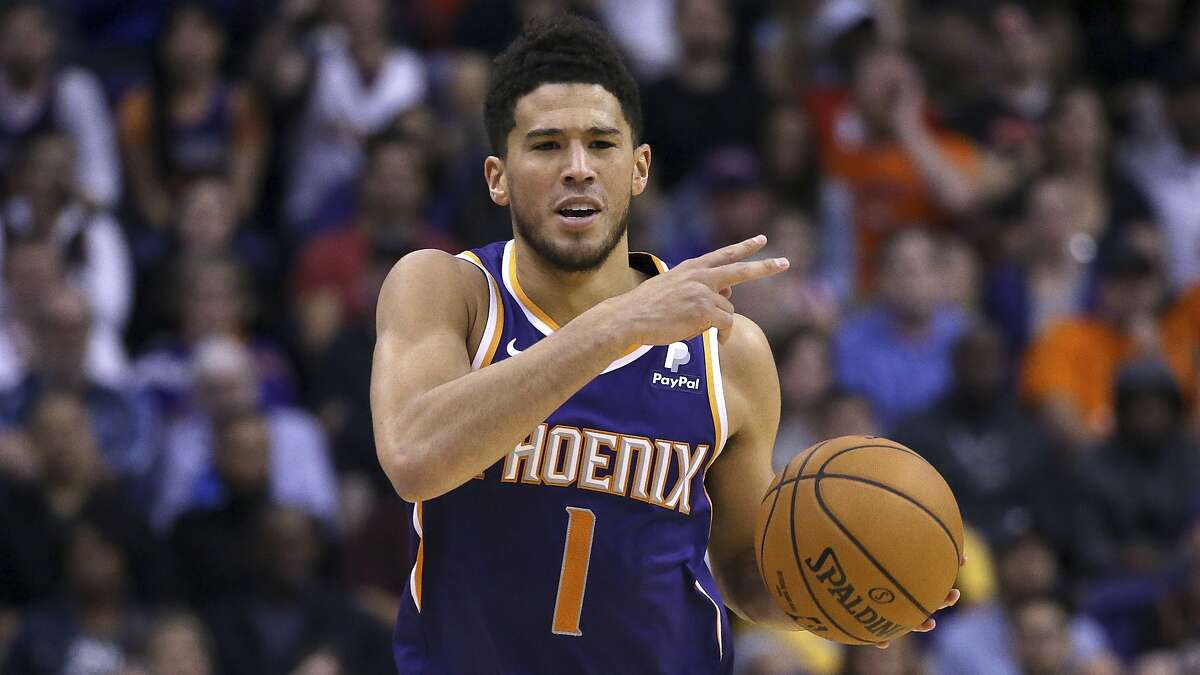Phoenix Suns guard Devin Booker dribbles the ball against the LA Clippers during the second half of a basketball game Saturday, Oct. 26, 2019, in Phoenix. The Suns defeated the Clippers 130-122. (AP Photo/Ross D. Franklin)