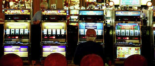 Few gamblers are found on the floor of the Mohegan Sun Casino on Thursday, Nov. 19, 2009.  Increasing competition from other states means Connecticut could see less revenue from gambling, which has already taken a hit due to the recession. Photo: Phil Noel, GT / Connecticut Post