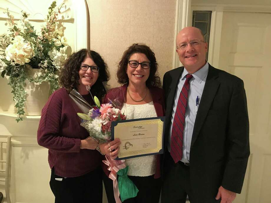 Wesley Village and United Methodist Homes recently announced several honors. Pictured are, left to right, Elizabeth Bemis, VP of marketing and sales, Lisa Bisson, director of community outreach, and Dave Lawlor, UMH president and CEO. Photo: Contributed Photo / Connecticut Post