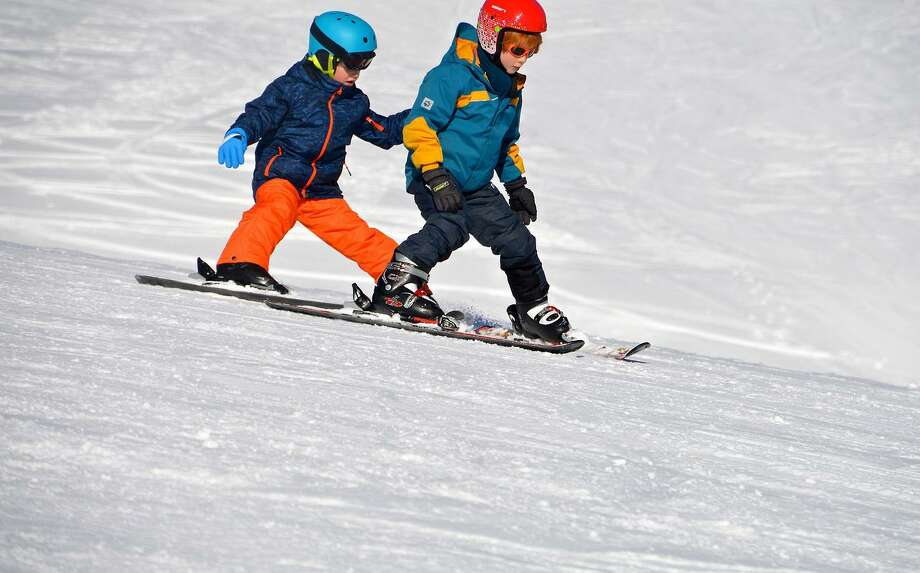 Sign up for ski or snowboard lessons through Parks & Recreation, you will save compared to the regular rates. Photo: Contributed Photo.