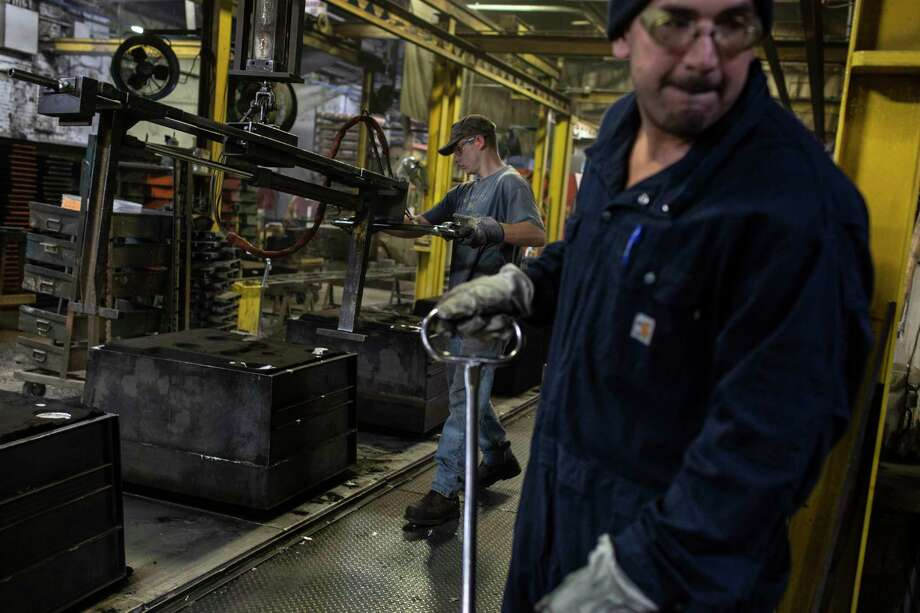Employees work at Wisconsin Aluminum Foundry in Manitowoc, Wisc. Wisconsin Aluminum Foundry has seen orders collapse during an emerging recession in the manufacturing sector. Photo: Photo For The Washington Post By Lianne Milton / For The Washington Post