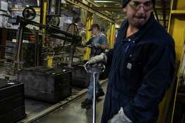 Employees work at Wisconsin Aluminum Foundry in Manitowoc, Wisc. Wisconsin Aluminum Foundry has seen orders collapse during an emerging recession in the manufacturing sector.