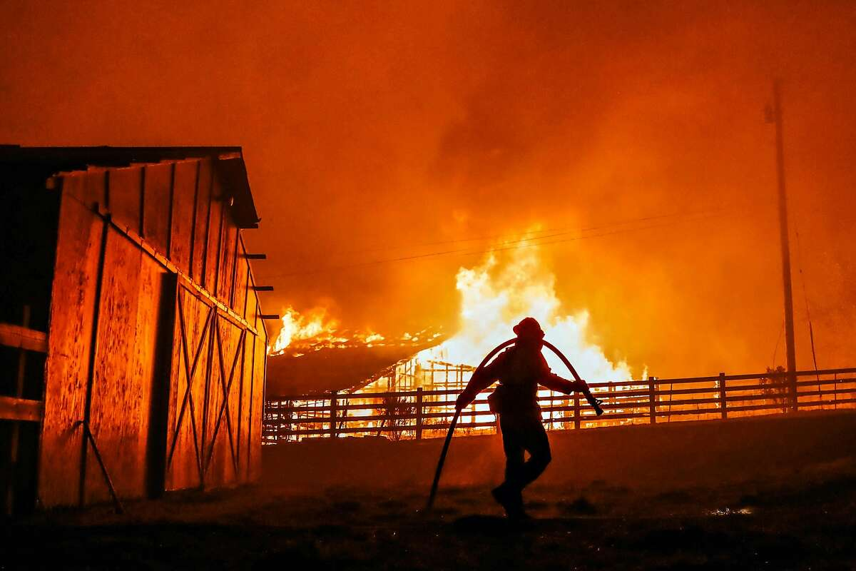 Fire fighters from Palo Alto Engine Co 65, fight to save a farm on Chalk Hill Road, near Windsor Calif. on Sunday, October 27, 2019.
