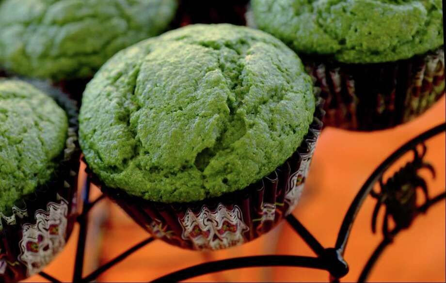 Green is a strange color for banana muffins. Can you guess the secret ingredient in these Frankenmuffins? Photo: Toni L. Sandys, The Washington Post / The Washington Post / The Washington Post