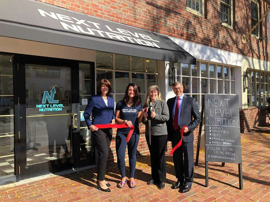 From left, Beverly Balaz, President/Fairfield Chamber of Commerce; Megan Uhrynowski/Owner; Nancy Carberry/Fairfield Chief of Staff; Mark Barnhart/Fairfield Director of Community & Economic Development. Photo: Contributed Photo