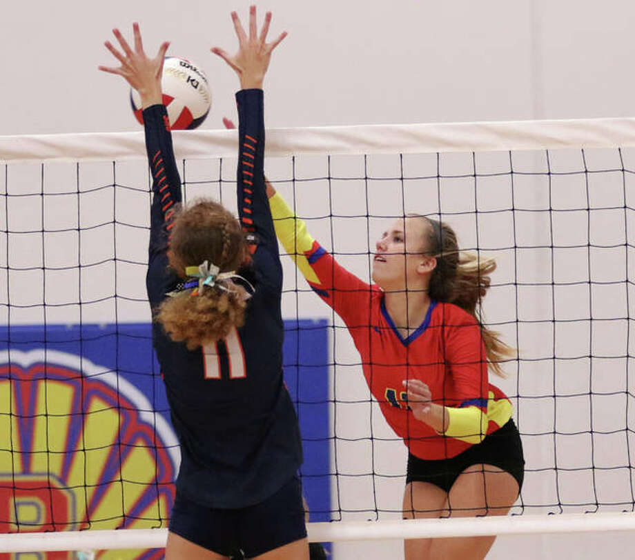 Roxana's Olivia Mouser (right) is shown attacking past a block in a home match Sept. 19 against Pana. The Shells defeated Southwestern on Monday to advance to the semifinals at the EA-WR Class 2A Regional. Photo: Greg Shashack / The Telegraph
