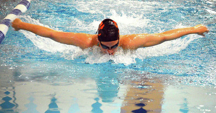 Edwardsville's Josie Bushell swims the butterfly during practice at Chuck Fruit Aquatic Center.