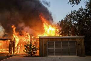A home along Highway 128 burns during the Kincade Fire in Healdsburg, Calif., on Oct. 27, 2019.