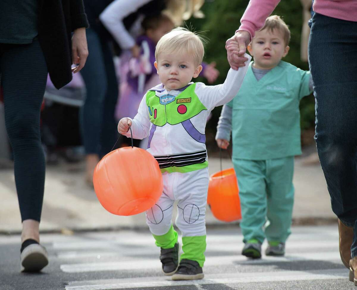 Darien kids dressed in Halloween costumes at the Darien Community Association's 24th annual Mom's Morning in Halloween Parade on Friday, Oct. 26, 2019 in Darien, Conn. Stevenson said contact tracing has revealed viral spread has been mostly occurring through private social gatherings, carpooling and youth sports.