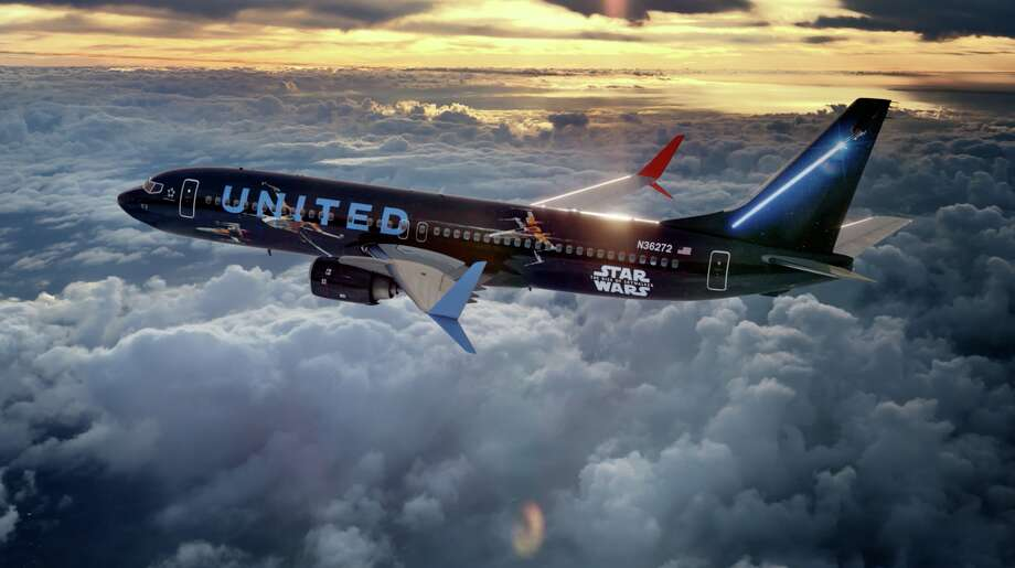 United Airlines has announced that it's launching an out-of-this-galaxy airplane in partnership with Star Wars. The plane is decked out with Star Wars-themed paint design, including X-wing and TIE fighter starships and a colored lightsaber. Photo: Courtesy