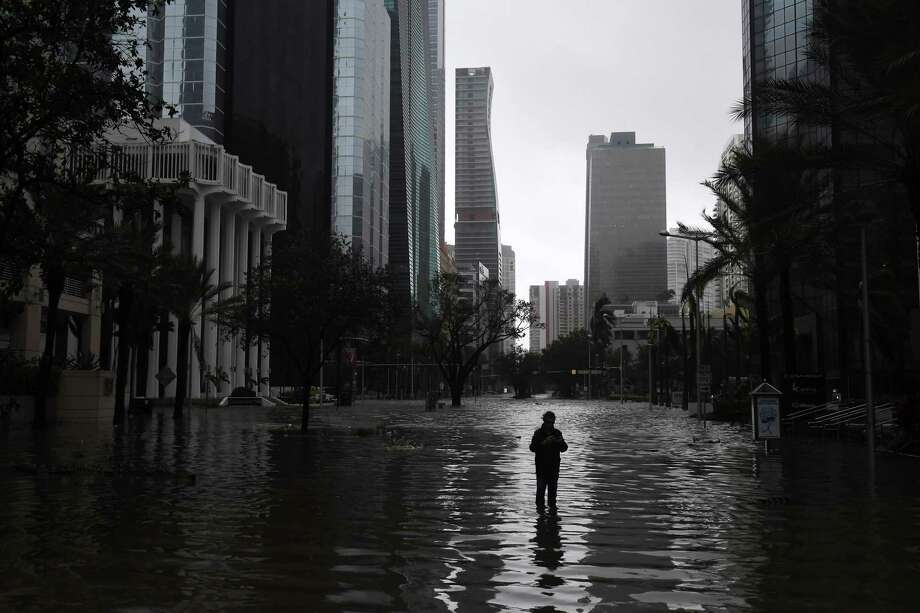 A man stands in a flooded street as Hurricane Irma hits the area on September 10, 2017 in Miami. Photo: Washington Post Photo By Matt McClain / The Washington Post