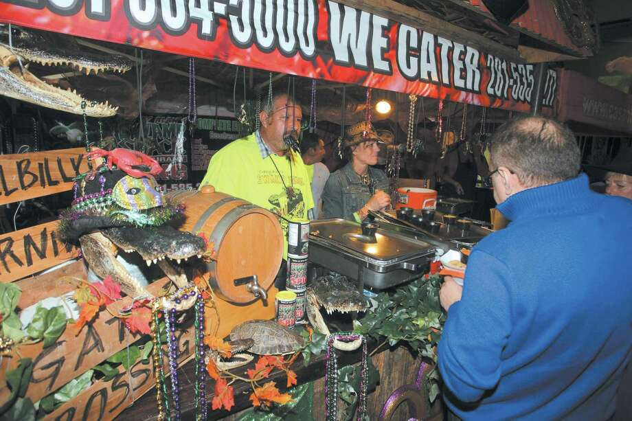 Crazy Alan's Swamp Shack's booth was a hot spot at the 2014 Taste of the Town. Set for Nov. 7 this year, the chamber event is marking its 30th anniversary. This year has a jungle theme, and participating restaurants will decorate with vines. Photo: Kar B Hlava