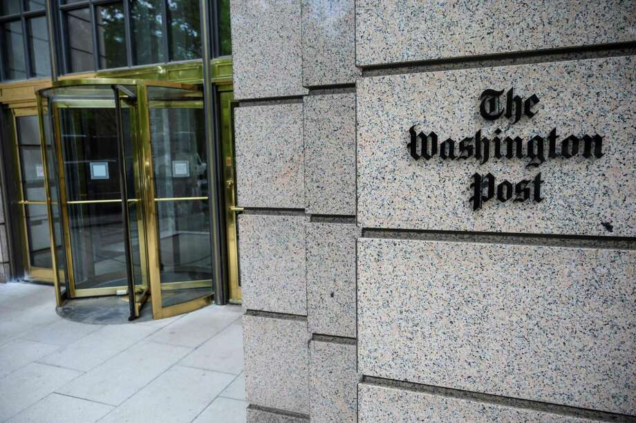 """In this file photo taken on May 16, 2019 the building of the Washington Post newspaper headquarters is seen on K Street in Washington DC. - President Donald Trump doesn't like what he reads in two of America's biggest newspapers, The New York Times and Washington Post — so he won't be getting them anymore."""" We did not renew our subscription, that is correct. This will be a significant cost savings to taxpayers,"""" White House spokeswoman Stephanie Grisham told AFP. Photo: Eric Baradat / AFP Via Getty Images / AFP or licensors"""