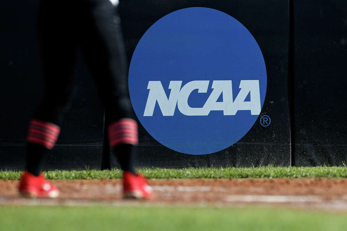 FILE - In this April 19, 2019, file photo, an athlete stands near a NCAA logo during a softball game in Beaumont, Texas.