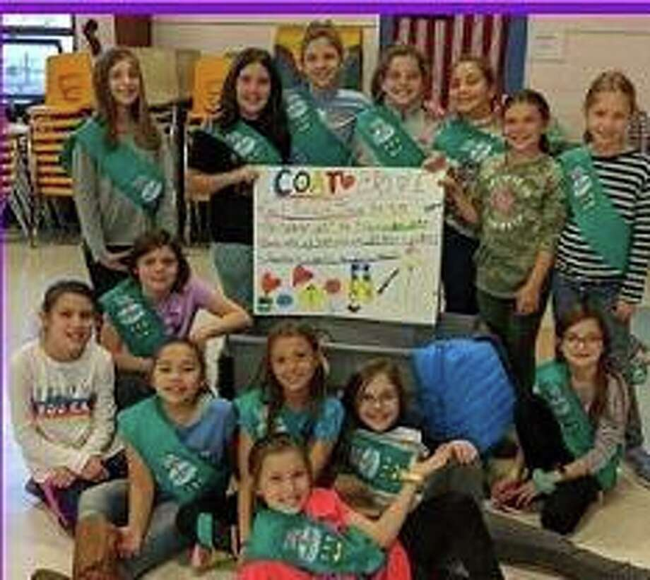 Girl Scout Troop 3410, made of fourth graders from Monroe Elementary School, is collecting coats, jackets, snow suits and snow pants for the needy. Photo: Town Of Monroe / Contributed