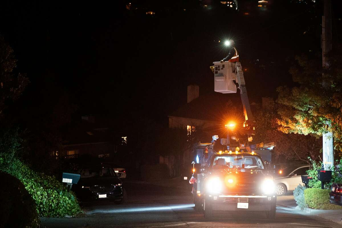 Kevin Stephens, a PG&E employee, restores the power on Sims Drive in Oakland, Calif. on Monday, Oct. 28, 2019.