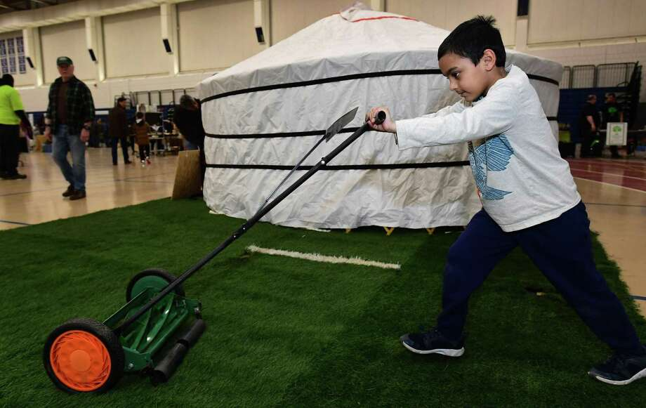 Rohan Sardana, 6, of Wilton tries out a push mower from MowGreen.com during the Wilton Go Green 2nd Annual Zero Waste Faire on Saturday, March 23, 2019, at the Wilton High School Field House. Photo: Erik Trautmann / Hearst Connecticut Media / Norwalk Hour