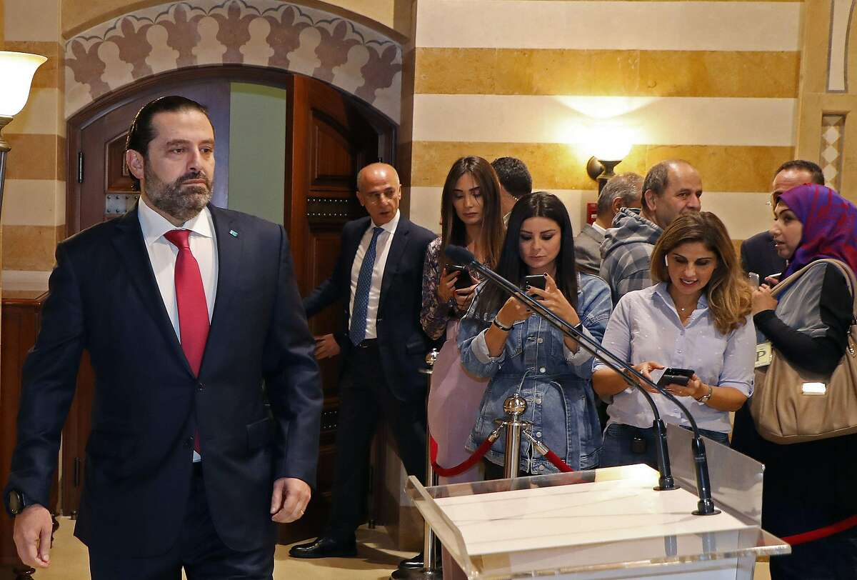 """TOPSHOT - In this handout picture provided by the Lebanese photo agency Dalati and Nohra, Lebanon's Prime Minister Saad Hariri walks to the podium to announce the resignation of his governmentt in the capital Beirut on October 29, 2019, bowing to nearly two weeks of unprecedented nationwide protests. - Hariri's express and sombre televised address was met by cheers from crowds of protesters who have remained mobilised since October 17, crippling the country to press their demands. (Photo by - / DALATI AND NOHRA / AFP) / === RESTRICTED TO EDITORIAL USE - MANDATORY CREDIT """"AFP PHOTO / HO / DALATI AND NOHRA"""" - NO MARKETING - NO ADVERTISING CAMPAIGNS - DISTRIBUTED AS A SERVICE TO CLIENTS === (Photo by -/DALATI AND NOHRA/AFP via Getty Images)"""
