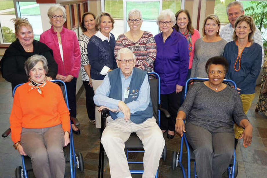 AMH White Cross Auxiliary members display the new Staxi transport chairs in the Duncan Wing lobby. Seated in the chairs, from left, are Irene McLaughlin, Dick Propes and Ellar Duff. Standing, from left, are Sandy Lauschke, Debbie Miller, Kathleen Turner, Debbie Gates, Mary Eckhouse, Jean Rathgeb, Nancy Simpson, Mary Yanta, David Knowles and Julie Schranck.