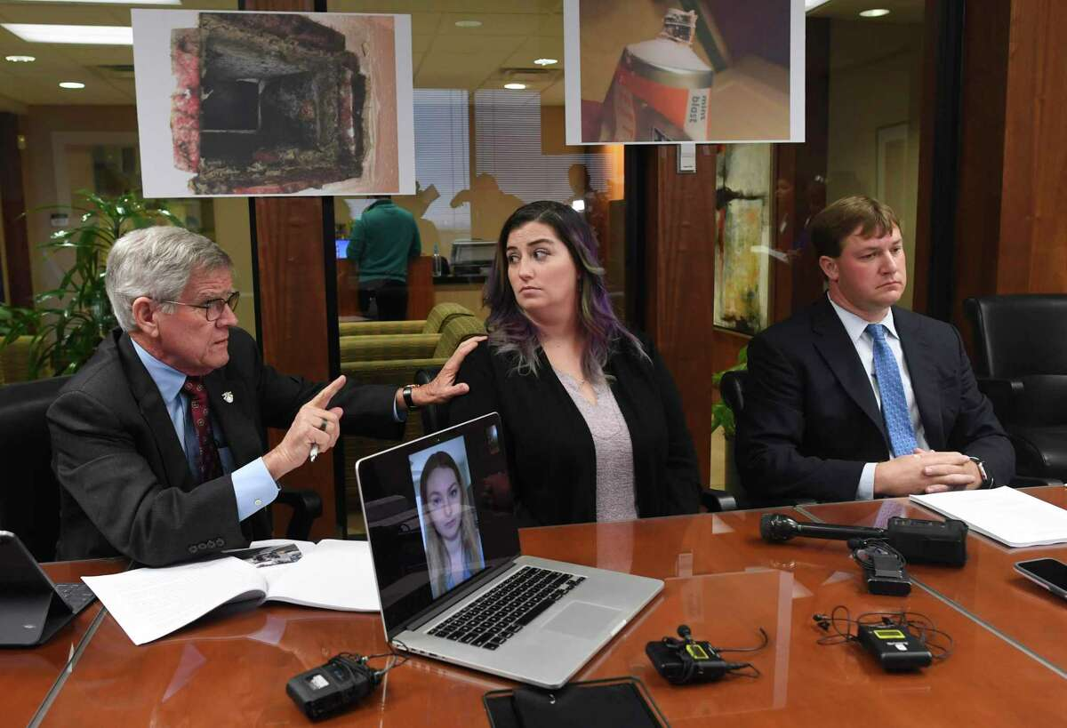 Attorneys James R. Moriarty, left, and Ryan C. Reed, right, and clients Kassandra Wolf, middle, and Megan Konzen, onscreen, talk to reporters Tuesday at the Pulman, Cappuccio and Pullen law firm office about a lawsuit against a private housing contractor over problems with mold and other issues at Joint Base San Antonio-Randolph and Laughlin AFB near Del Rio.