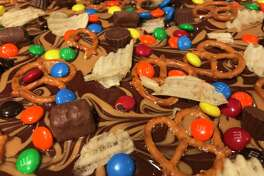 Looking for a creative way to use up leftover Halloween candy? Try this sweet and salty bark recipe.
