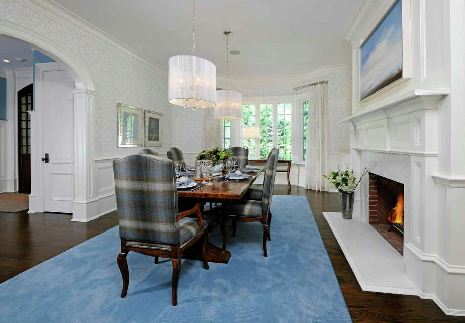 The statuesque brick manor at 22 Cornelia Drive in Greenwich is listed for $6.8 million by Coldwell Banker Residential Brokerage. Its floor plan is based on an open plan design, with formal living and dining rooms, a butler's pantry, temperature-controlled wine room and Christopher Peacock kitchen. Photo: Contributed Photo