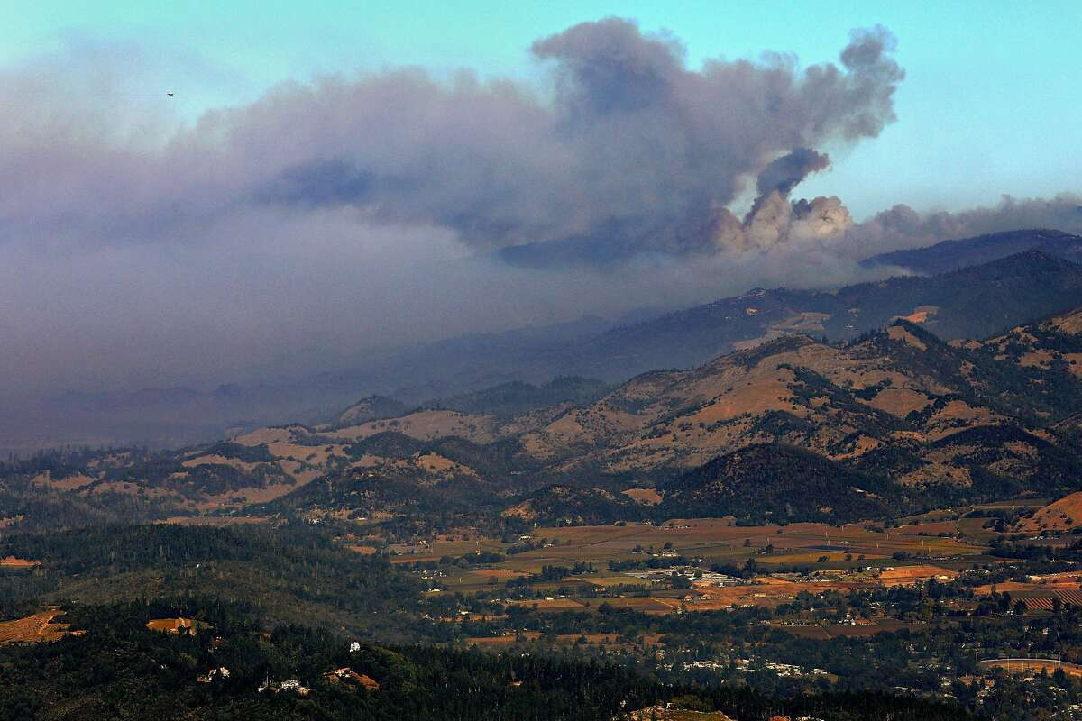 A smoke plume from the Kincade Fire is seen just north of Mt. Saint Helena on Tuesday, Oct. 29, 2019.