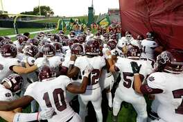 The Cy-Fair Bobcats huddle before taking the field during the high school football game between the Cypress Falls Eagles and the Cy-Fair Bobcats at Pridgeon Stadium in Houston, TX on Friday, October 4, 2019. The Bobcats defeated the Eagles.