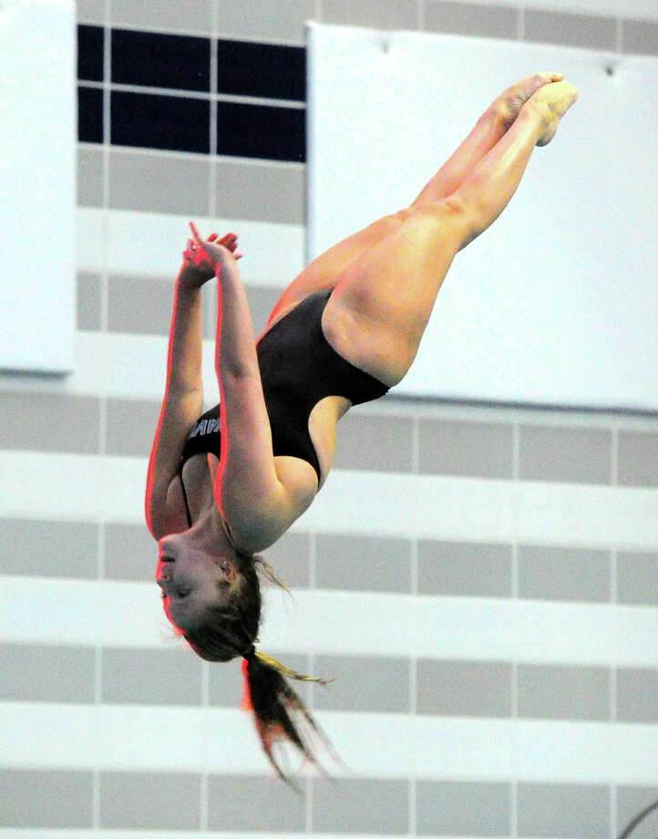 Darin's Julia Servas competes during state open diving championship action at Middletown High School in Middletown, Conn., on Friday Nov. 16, 2018. Photo: Christian Abraham / Hearst Connecticut Media / Connecticut Post