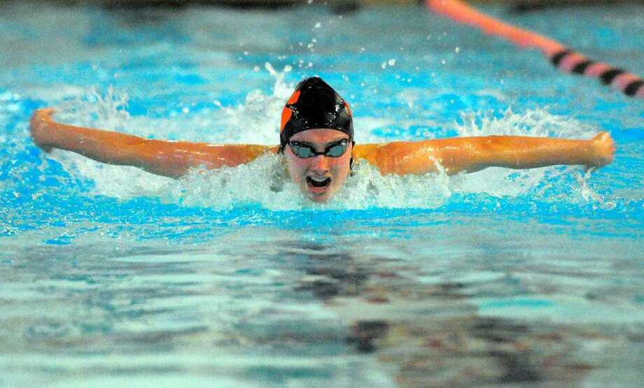 Hannah Seward competes in the butterfly during Ridgefield's season-opening meet against Greenwich. Photo: Christian Abraham / Hearst Connecticut Media