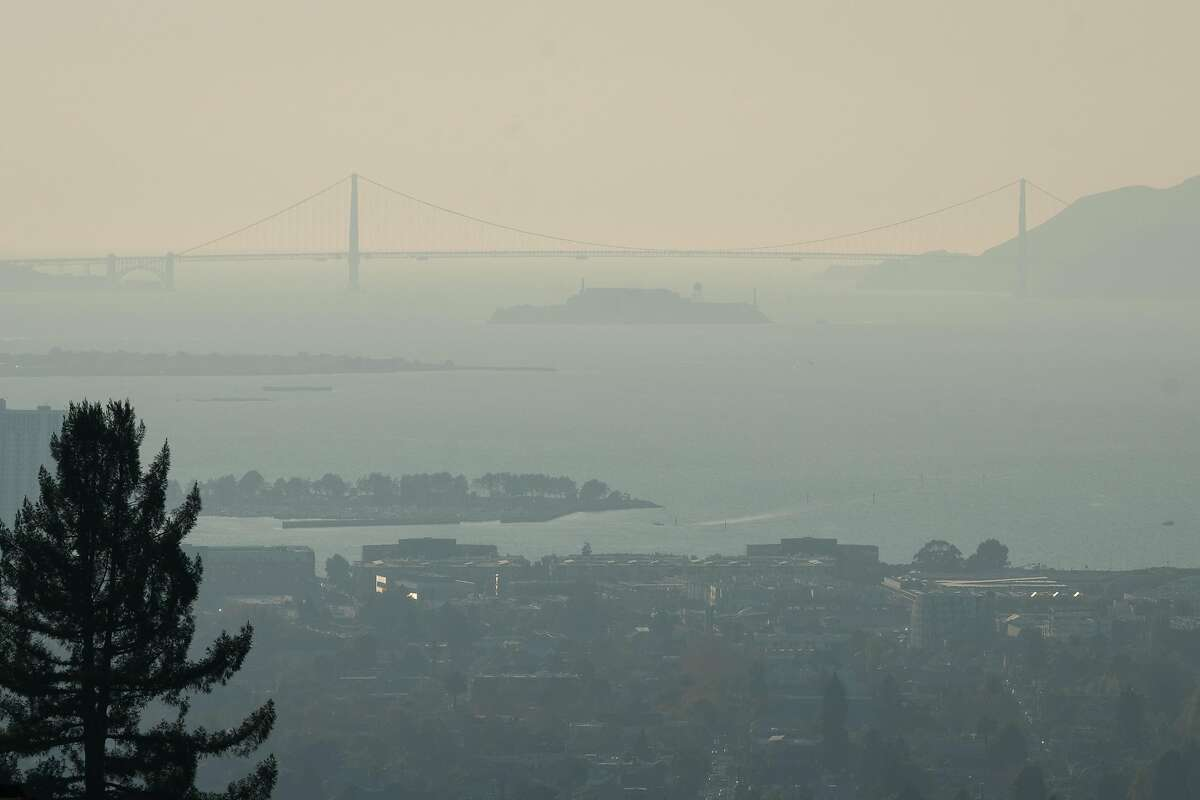 A hazy view of the Golden Gate Bridge is seen from Hiller Drive in Oakland, Calif. on Monday, Oct. 28, 2019.