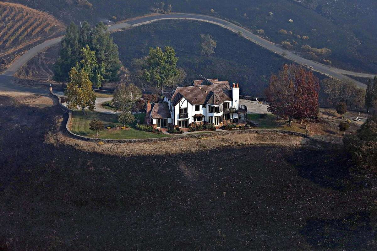 A home between Healdsburg and Windsor seen on Tuesday, Oct. 29, 2019, is surrounded by charred ground but was spared from the Kincade Fire flames.