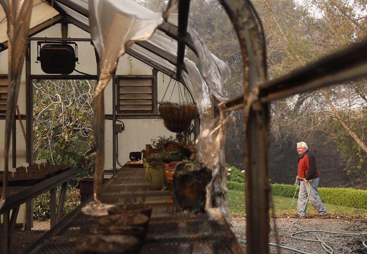 Hank Wetzel, 68, walks through his garden and past a charred greenhouse while working with Cal Fire Damage Inspection to assess his property along Highway 128 in Healdsburg, Calif, Tuesday, October 10, 2019 after a handful of buildings were destroyed by the Kincade Fire.