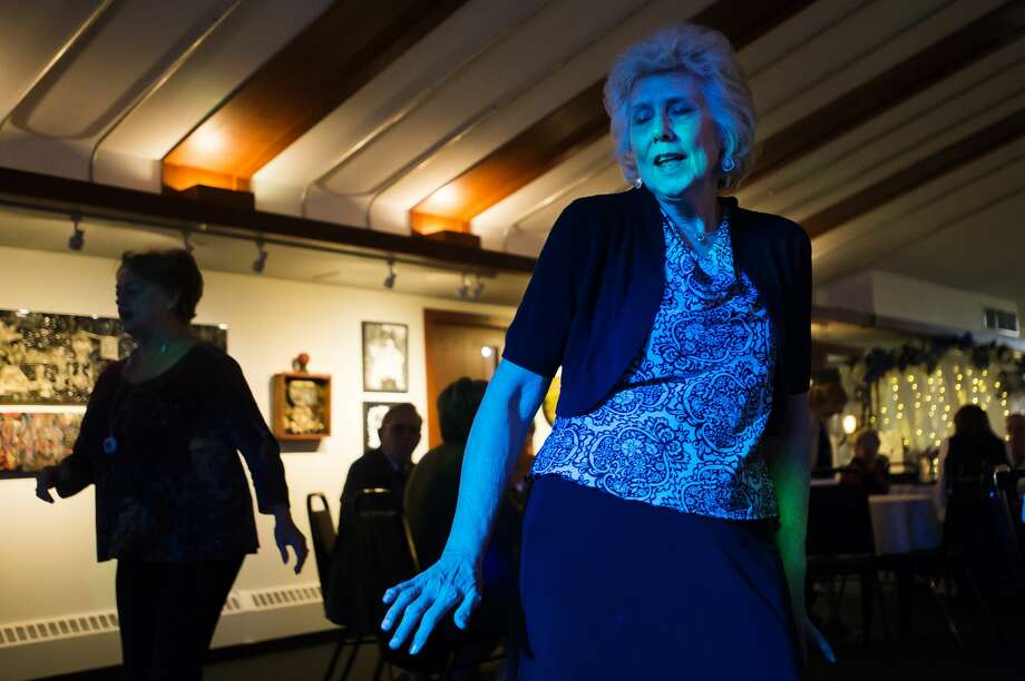 Midland resident Sharon Hale dances with friends Tuesday, Oct. 29, 2019 during a Senior Prom hosted by Midland Daily News at Creative 360. (Katy Kildee/kkildee@mdn.net) Photo: (Katy Kildee/kkildee@mdn.net)